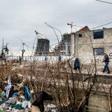 Derelict warehouses behind Belgrade central train station offered refugees little protection from the bitter Serbian winter