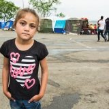 Young girl at an informal refugee camp behind the EKO service station on the road to Idomeni