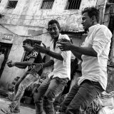 Dancing on the street - family puja