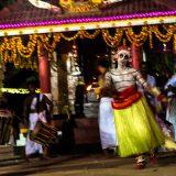 Ritual dance by Theyyam artist embodying the spirit of the Hindu deity Gulikan