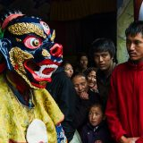 Audience members gather round a Masked performer during the Hemis Tsechu Festival at Hemis Gompa (Buddhist monastery)