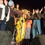 Moroccan singer Oum invites women from the audience to join her on stage at the Taragalte Festival, M'Hamid El Ghizlane