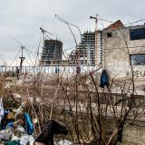 Portfolio, Dilapidated buildings on railway wasteland offered refugees little protection from the Serbian winter