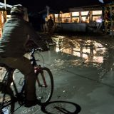Portfolio, Fluorescent lights illuminated the water-logged road through the heart of the Southern area of the camp